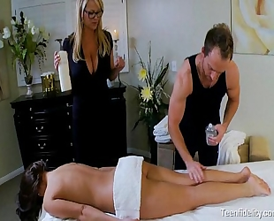 Teen tempted by a breasty milf masseuse and her spouse