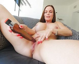 Frisky MILF with big honkers fucks herself with a huge toy