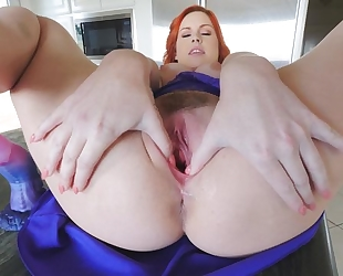 Stunning redhead chick with big naturals masturbates in the kitchen
