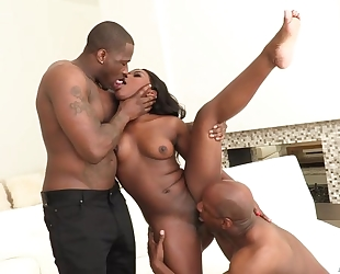 All-natural ebony gets both of her holes stuffed with huge dicks