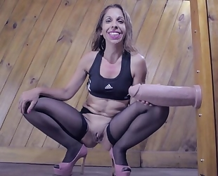Crazy MILF gets down on all fours and welcomes in massive sex toy