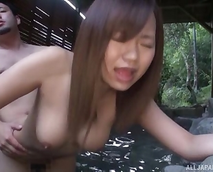 Beautiful Asian girl with perky tits gets fucked in the water