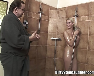 Lucky daddy bonks blond stepdaughter in the shower